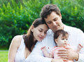 Happy young family with baby girl Royalty Free Stock Photos