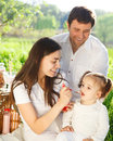 Happy young family with baby girl on a picnic spring Royalty Free Stock Photo