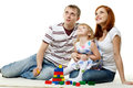 Happy young family with child lovely daughter build house on a white background concept of building and purchase of the house Royalty Free Stock Photography