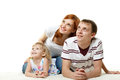 Happy young family with child parents lovely daughter lie on a white background Royalty Free Stock Photo