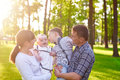 Happy young family with children walks in the summer park Royalty Free Stock Photo