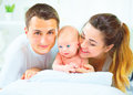 Happy young family. Father, mother and their newborn baby Royalty Free Stock Photo