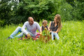 Happy young family having picnic in public park Royalty Free Stock Photo