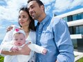 Happy young family at home couple with beautiful new born baby have fun modern Stock Photo
