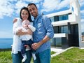 Happy young family at home couple with beautiful new born baby have fun modern Stock Image