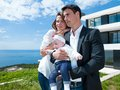 Happy young family at home couple with beautiful new born baby have fun modern Stock Photography