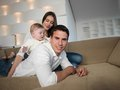 Happy young family at home couple with beautiful new born baby have fun modern Royalty Free Stock Image