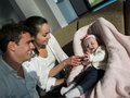 Happy young family at home couple with beautiful new born baby have fun modern Stock Photos