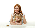 Happy young family mother with sweet little daughter lay on a white background concept of care and protection Stock Image