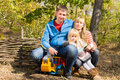 Happy young family outdoors in woodland Royalty Free Stock Photo