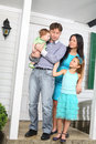 Happy young family stand on porch of new house Royalty Free Stock Photo