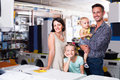Happy young family with two children shopping Royalty Free Stock Photo