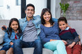 Happy young family watching tv in living room Royalty Free Stock Images