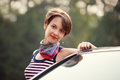 Happy young fashion woman next to her car Royalty Free Stock Photo