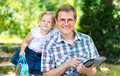Happy young father with daughter in summer park Royalty Free Stock Photo