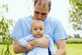 Happy young father kissing his newborn son outdoor Royalty Free Stock Photo