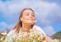 Beautiful woman enjoying daisy field and blue sky Royalty Free Stock Photo
