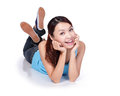 Happy young female student woman lying on floor isolated on white background asian Royalty Free Stock Image