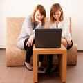 Happy young females enjoying using laptop Stock Image