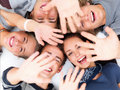 Happy young friends lying down giving high five Stock Photo