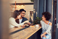 Happy young friends meeting in a coffee shop portrait of people sitting together at cafe having some food and group of Royalty Free Stock Image
