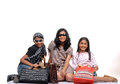 Happy young friends with shopping bags Stock Images