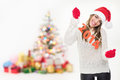 Happy young girl celebrating new year beautiful caucasian brunette woman holding number decoration wearing santa hat against Stock Photo