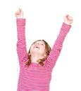 Happy young girl cheering with arms raised