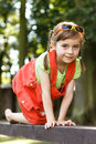 Happy young girl crawl on the beam in the park all fours Stock Photos