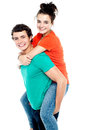 Happy young girl enjoying piggyback ride Royalty Free Stock Photos