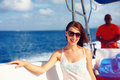 Happy young girl enjoys summer vacation in ocean cruise on powerboat woman Royalty Free Stock Photos