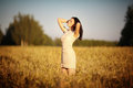 Happy young girl in field a Royalty Free Stock Images