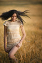 Happy young girl in field a Royalty Free Stock Photos