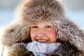 Happy young girl in a fur hat Stock Images