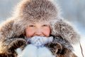 Happy young girl in a fur hat Royalty Free Stock Photo