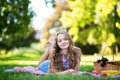 Happy young girl having a picnic Royalty Free Stock Photo