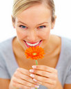 Happy young girl holding an orange flower Royalty Free Stock Photos