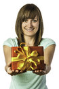 Happy young girl holding present brunette with green eyes and green shirt a red gift box with golden ribbon Stock Photography