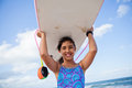 Happy young girl holding surfboard on head Stock Photos