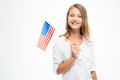 Happy young girl holding USA flag Royalty Free Stock Photo