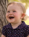 Happy young girl laughing Stock Image