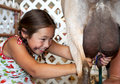 Happy Young Girl Learning To Milking A Goat Stock Image
