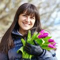 Happy young girl in paris with tulips a bunch of fresh beautiful Stock Photo