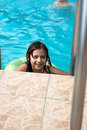 Happy young girl in pool Royalty Free Stock Image
