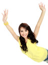 Happy young girl raised her hand portrait of a in action and looking at camera Stock Photos