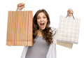 Happy young girl with shopping bags half length portrait of isolated on white concept of consumerism and purchase Royalty Free Stock Photo