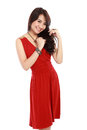 Happy young girl wearing red dress portrait of a in action isolated over white background Stock Photo