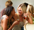 Happy young girls with drinks having fun Royalty Free Stock Photos