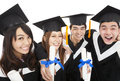 Happy young graduate students group Royalty Free Stock Photo
