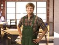 Happy young handyman in workshop carpenter smiling Royalty Free Stock Photos
